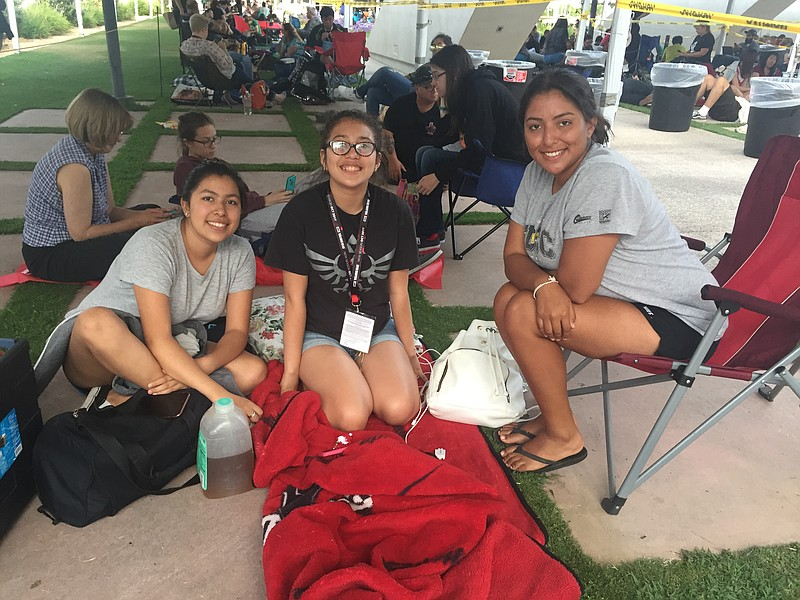 From left: Kristina Contreras, Alexa Hernandez and Angelica Contreras wait fi...
