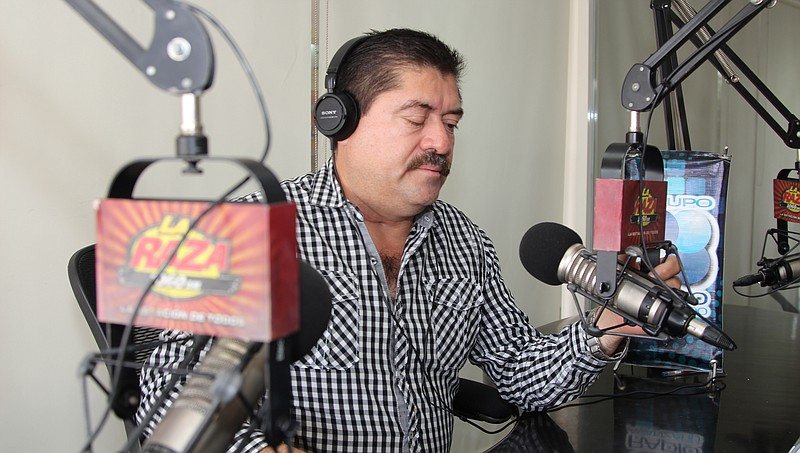 Mexican journalist Paco Rojas in a recording booth in Reynosa, Mexico, June 1...