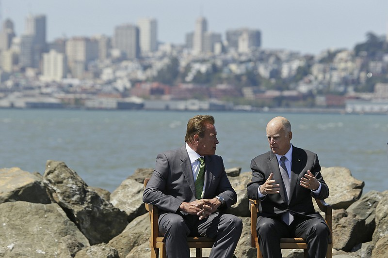 California Gov. Jerry Brown, right, and former Gov. Arnold Schwarzenegger, le...