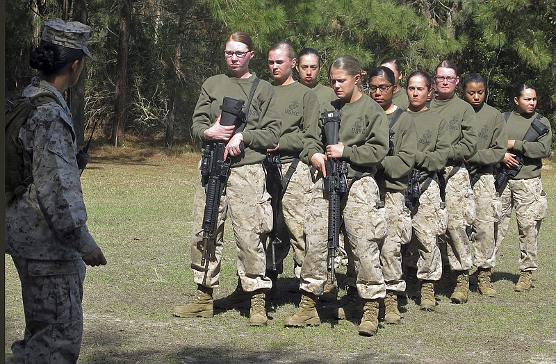 Female recruits stand at the Marine Corps Training Depot on Parris Island, S....