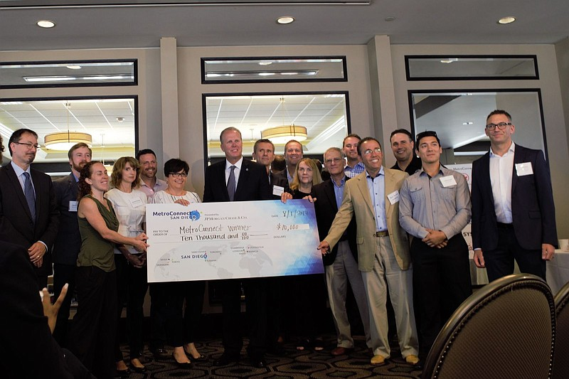 San Diego Mayor Kevin Faulconer (center) with recipients of this year's Metro...