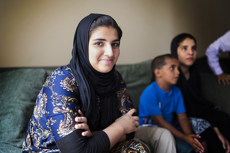 Saadia Hamdard sits on the couch in her family's two-bedroom apartment in El ...