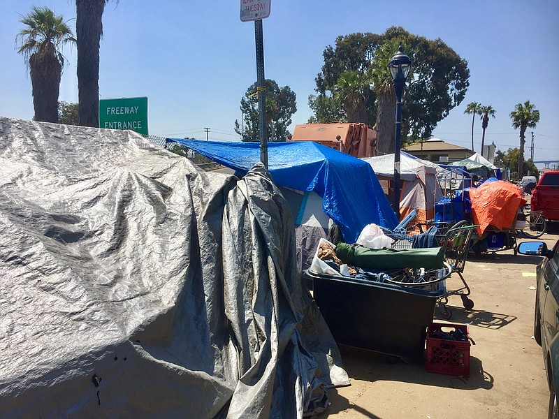 Encampments constructed by homeless people stretch down 17th Street in San Di...