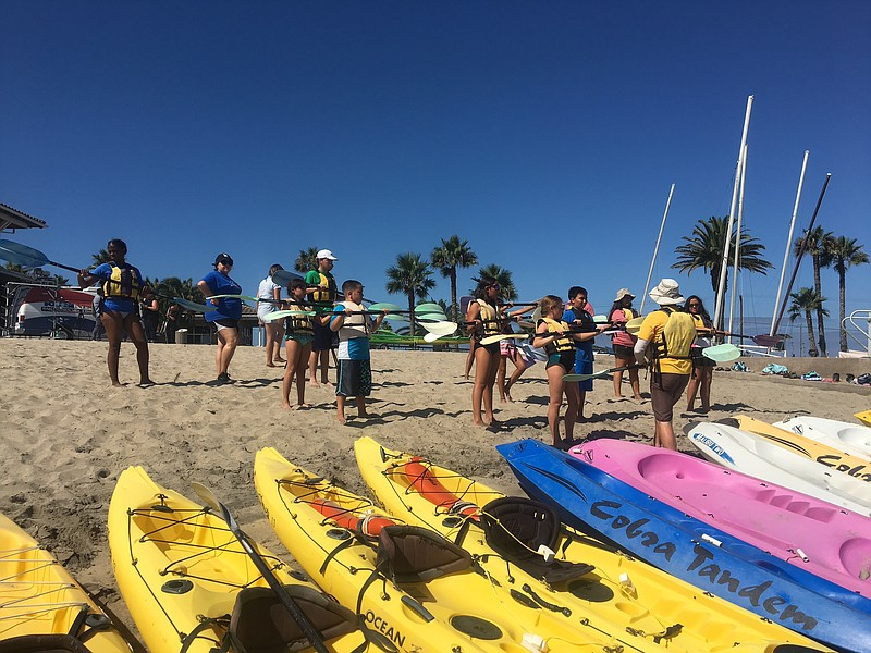Kids from Imperial Valley get ready to kayak at Silver Strand State Beach as ...