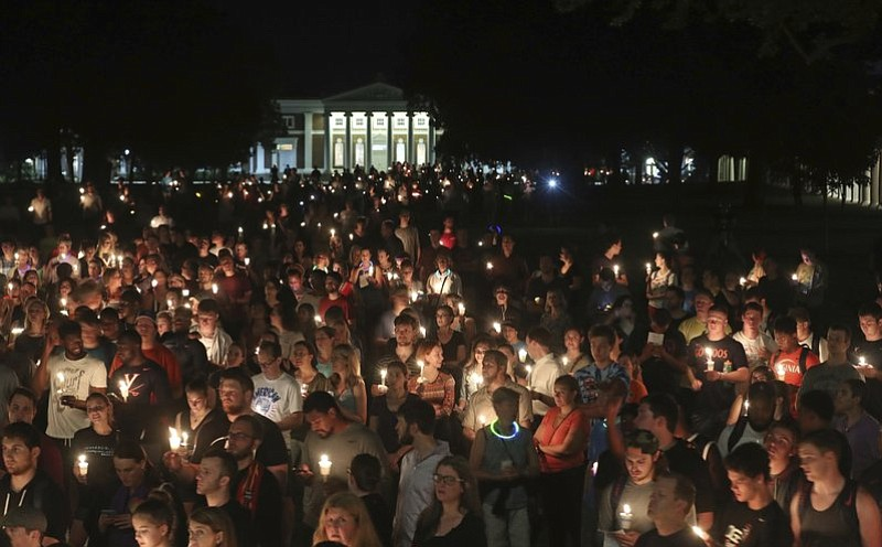 University of Virginia students, faculty and residents attend a candle light ...