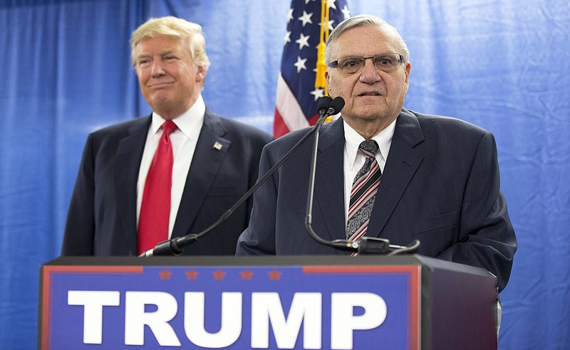 Then-Republican presidential candidate Donald Trump is joined by Joe Arpaio, ...