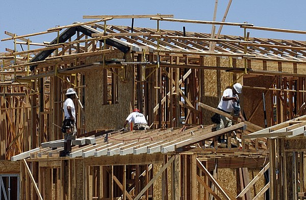 Construction workers build a new home in San Diego, July 13, 2006.