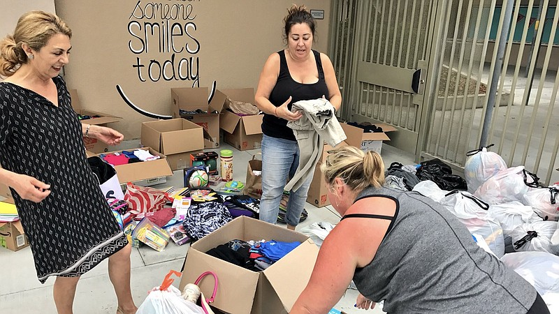 Sixth grade teacher Stacy Robe taking donations for Harvey victims at Pershin...