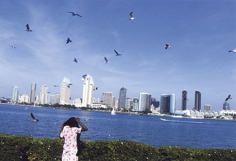 Amina, an immigrant from Kenya, looks at the San Diego skyline across the bay...