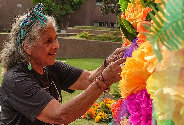 Master altar maker Ofelia Esparza creates her community altar at Grand Park, ...