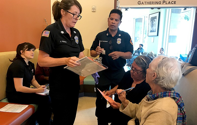 San Diego Fire-Rescue paramedics administer Hepatitis A vaccinations in the l...