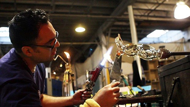 Glass artist Jaime Guerrero in the studio. Travel to and from the U.S. and Me...