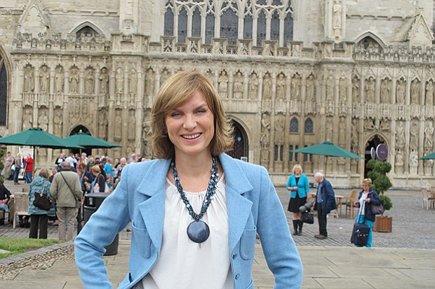 Presenter Fiona Bruce in front of Exeter Cathedral, Exeter, Devon, South West...