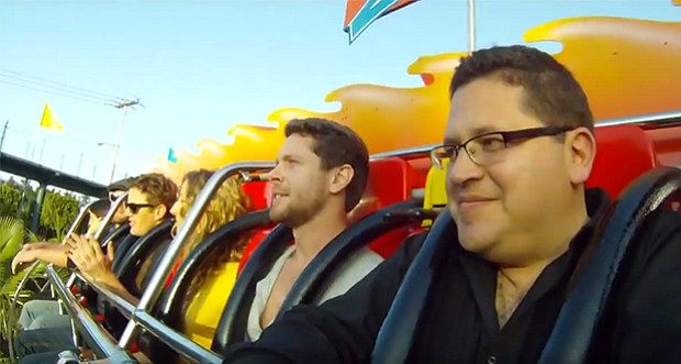 Host Jorge Meraz (right) visits Mundo Divertido to ride roller-coasters and o...