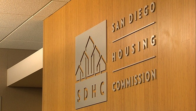 San Diego Housing Commission logo displayed on a wall inside the Commission's...