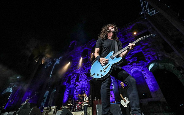 Foo Fighters frontman David Grohl performing at the Odeon of Herodes Atticus ...