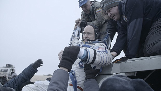 Scott Kelly returns to earth after a year in space.