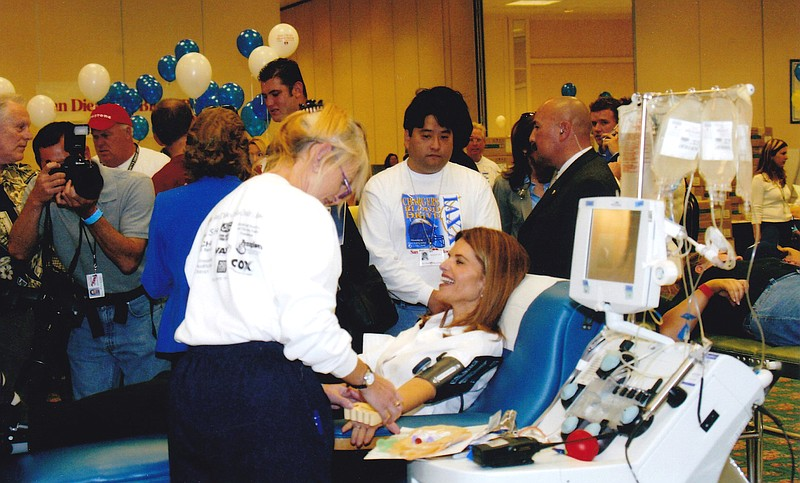 Former First Lady of California Maria Shriver gives blood at the Town and Cou...