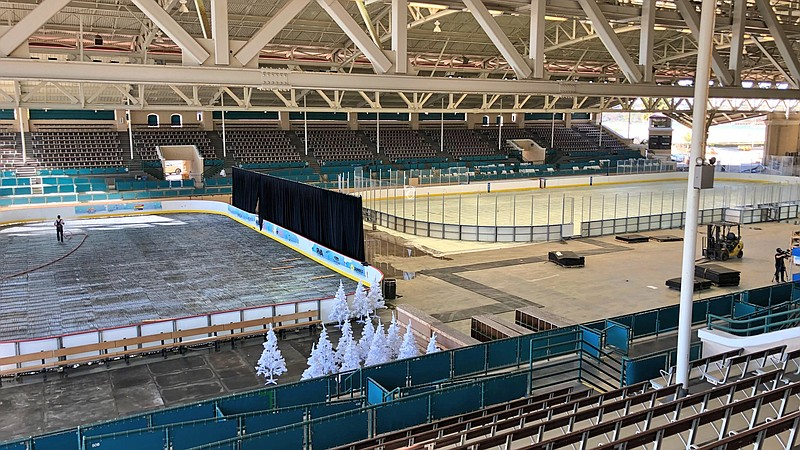 Inside the Del Mar Arena there is a smaller rink for public skate (left) and ...