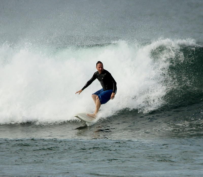 Douglas Bradley surfs in this undated photo.