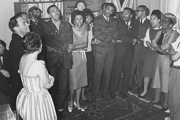 Lorraine Hansberry holds hands and sings with Singer Nina Simone and other ac...