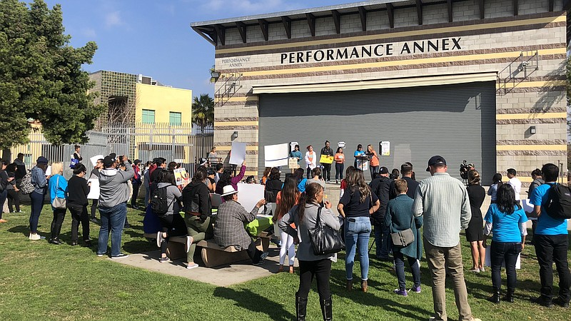 People gather outside the City Heights Performance Annex for a rally supporti...