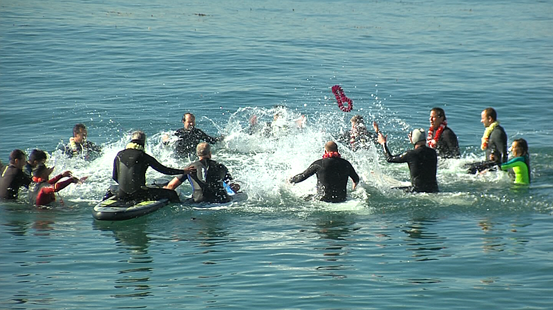 Friends of Douglas Bradley celebrate his life with a surfer's memorial paddle...