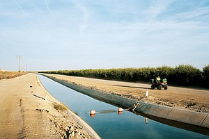 Photo for A Central Valley Farming Tycoon Seemed To Weather The Drought. But How Did He...