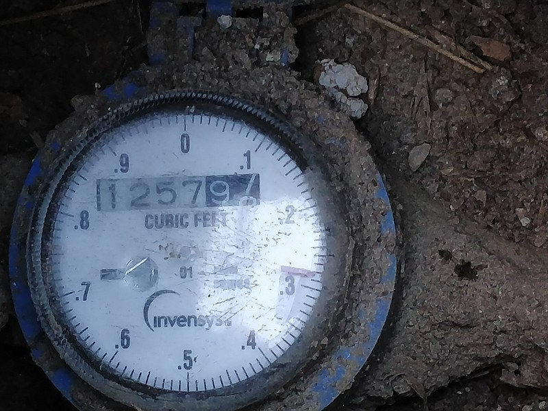 A water meter in the ground is shown at a home in Normal Heights, Dec. 24, 2017