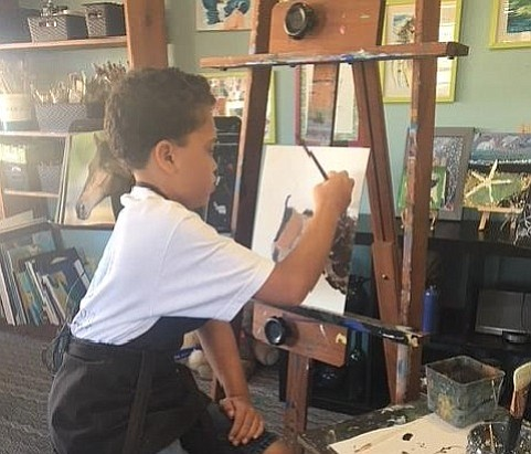 Josiah Love painting at Art Adventure Studio, in Oceanside, on February 1, 20...