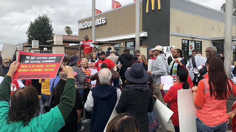 Minimum wage advocates rally in front of a McDonalds restaurant, Feb. 12, 2018.