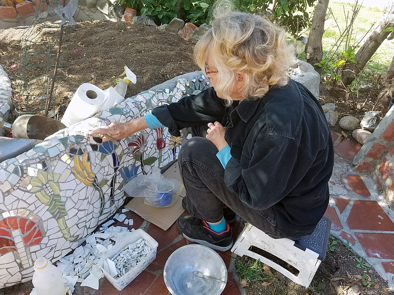 Lois Horowitz works on the mosaic in her front yard in Mira Mesa, Feb. 14, 2018.