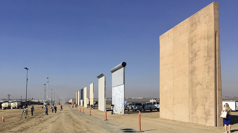 Border wall prototypes on display in San Diego, where contractors offer diffe...