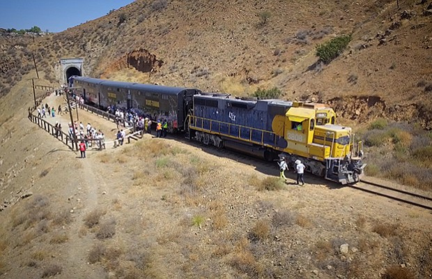 A passenger train takes a quick stop to see the view as it goes from Tijuana ...