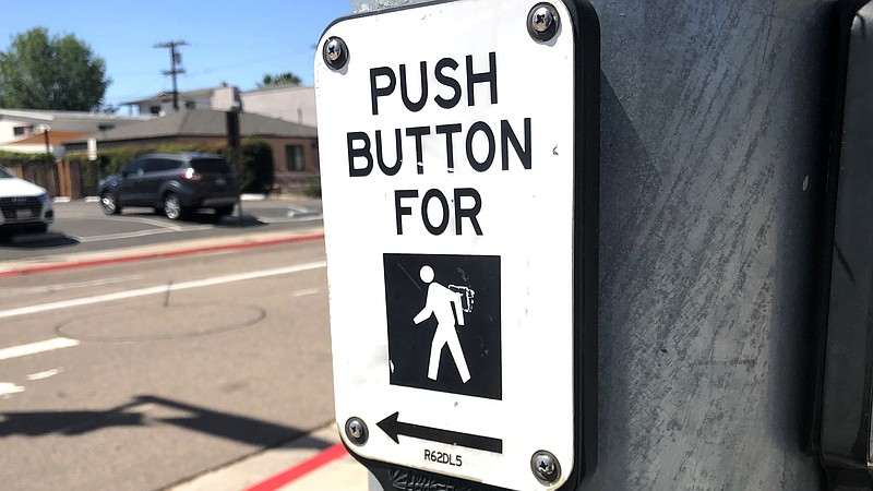 A crosswalk sign at a San Diego intersection, April 4, 2018.