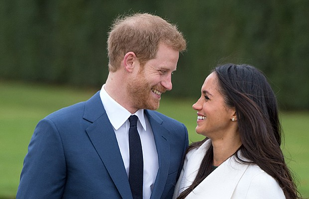 Prince Harry and Meghan Markle, wearing a white belted coat by Canadian brand...