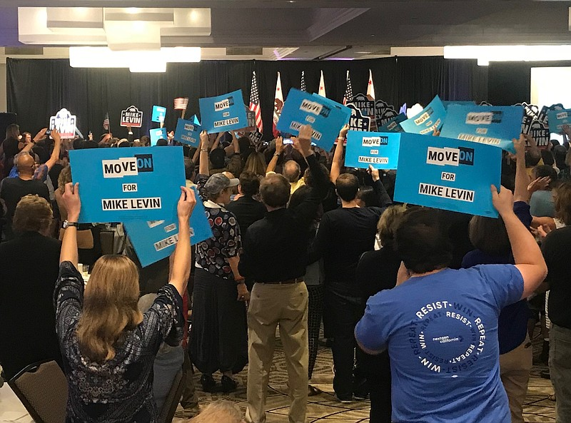 Volunteers and supporters at Democrat Mike Levin's victory party in Del Mar, ...