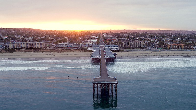 Aerial view of sunrise over Pacific Beach pier in San Diego, Calif. Featured ...