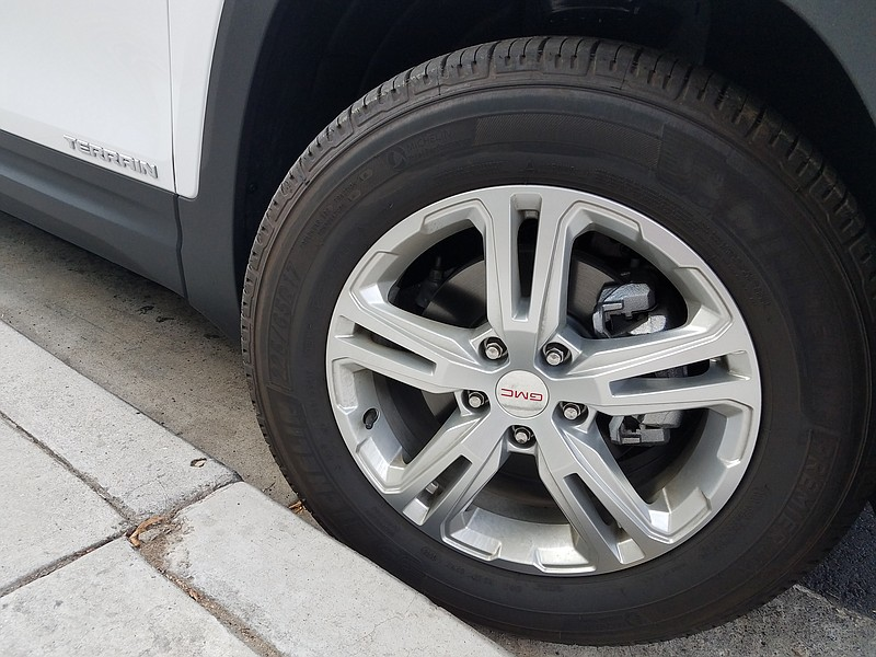 A car's wheel is cramped toward the curb in Mission Valley, Oct. 23, 2018.