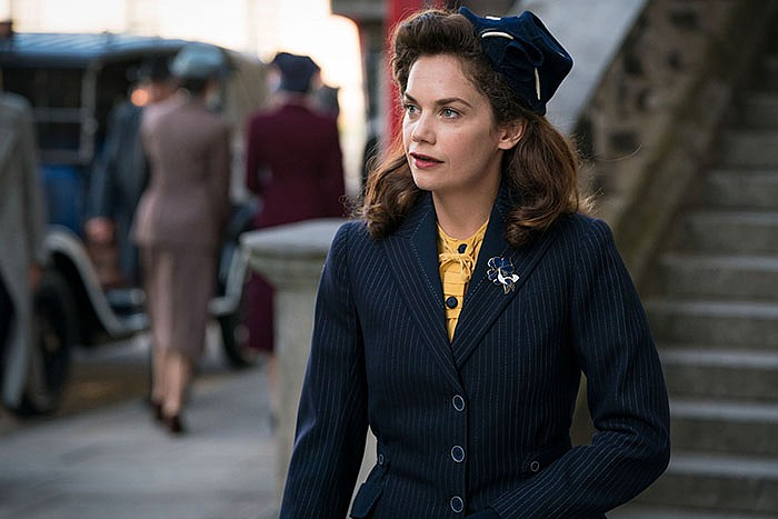 Ruth Wilson as Alison Wilson, a recent widow who discovers her spy novelist h...
