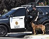 A San Diego police officer with a police dog wa...