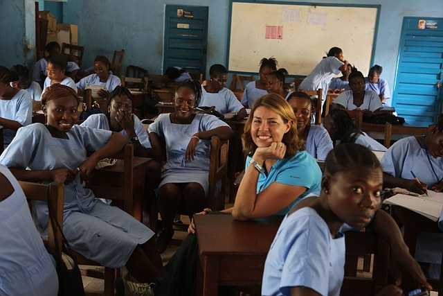 Erica Ollmann Saphire (center) sits with a group of nurses in Africa during a...