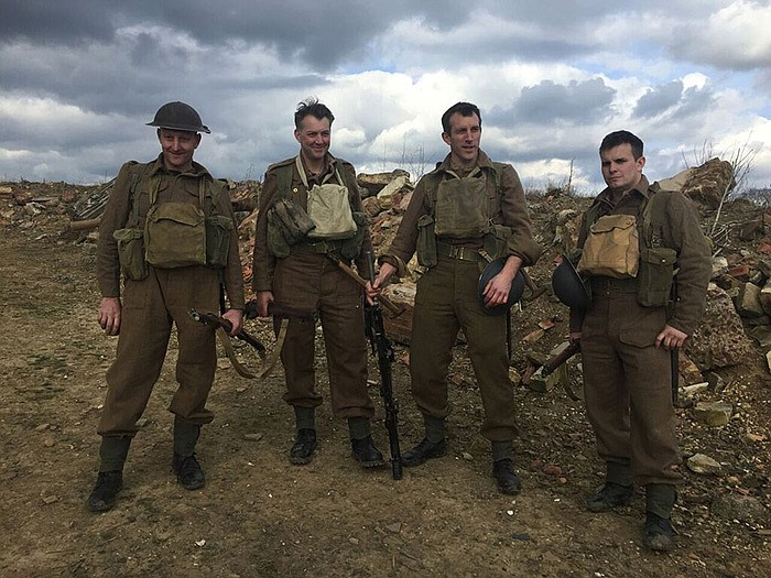 James Holland (second from left) and a group of history buffs in accurate kit...