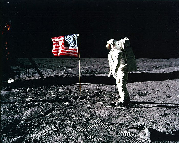 On July 20, 1969, Neil Armstrong and Buzz Aldrin (pictured with U.S. flag) se...