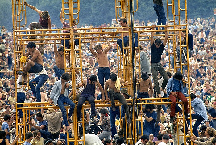 Bethel, New York, August 1969. The crowd and people sitting on the sound towe...