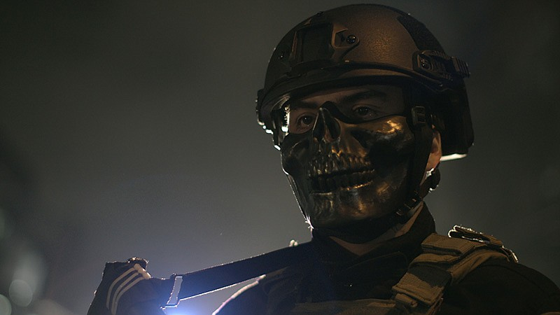 Pictured is a police officer on a night patrol in Manila, Philippines. In