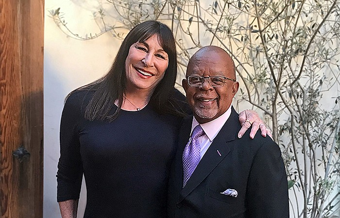 Host Henry Louis Gates, Jr. with actress Anjelica Huston while taping FINDING...