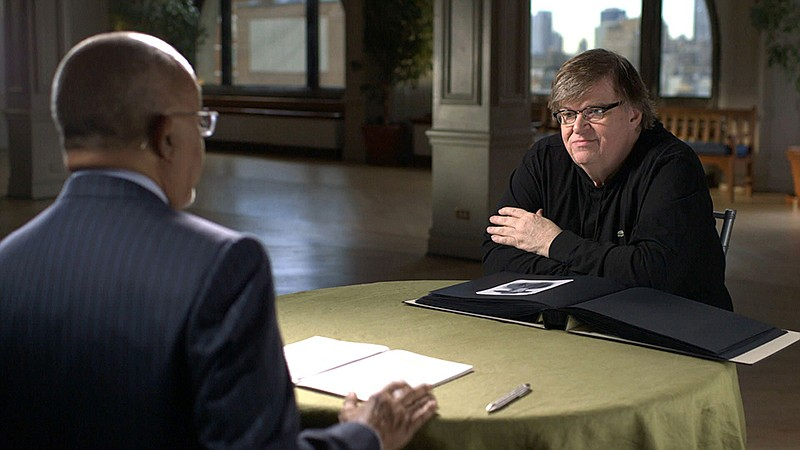 Host Henry Louis Gates, Jr. with filmmaker Michael Moore while taping FINDING...