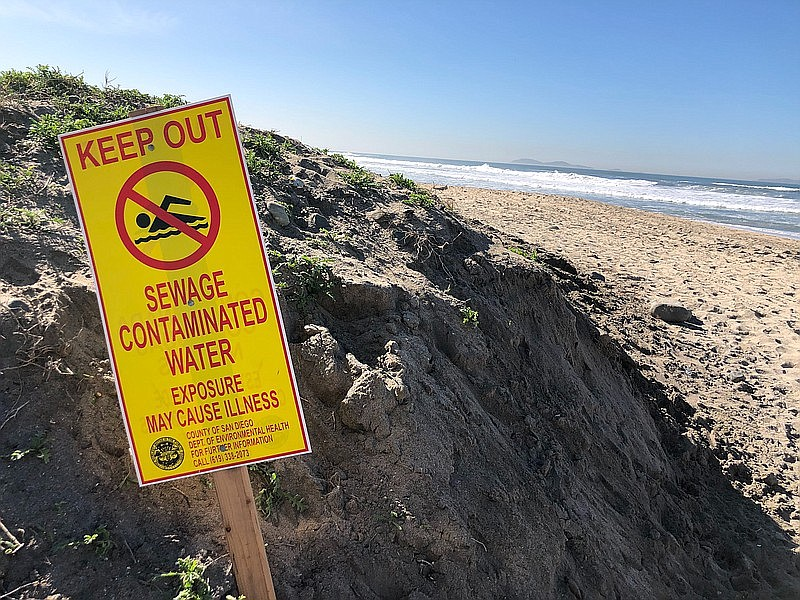 A sign displays a warning about contaminated water at Imperial Beach, Jan. 31...