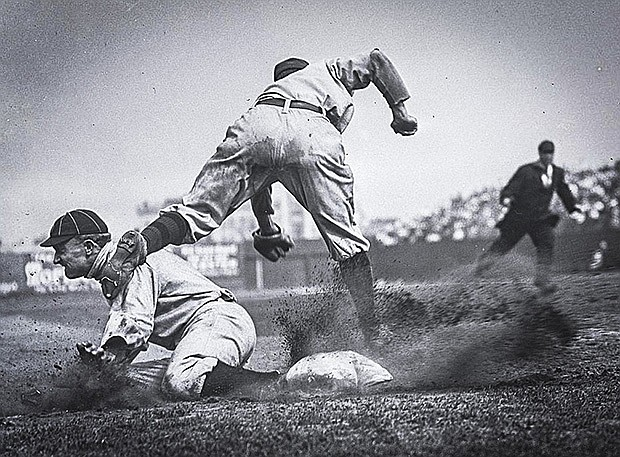 Charles M. Conlon's famous picture of Ty Cobb stealing third base during the ...